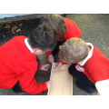 Team work - building the wooden shop for our outdoor area.