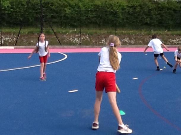 Practising throwing & striking with a rounders bat