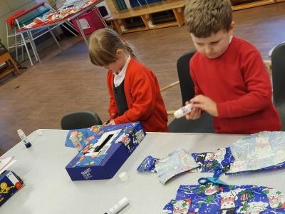 Decorating their Christmas card post boxes