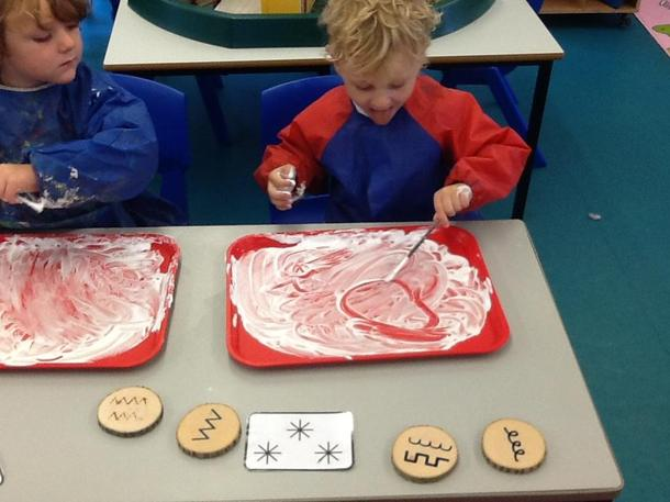 Writing our sounds in shaving foam/ mark making
