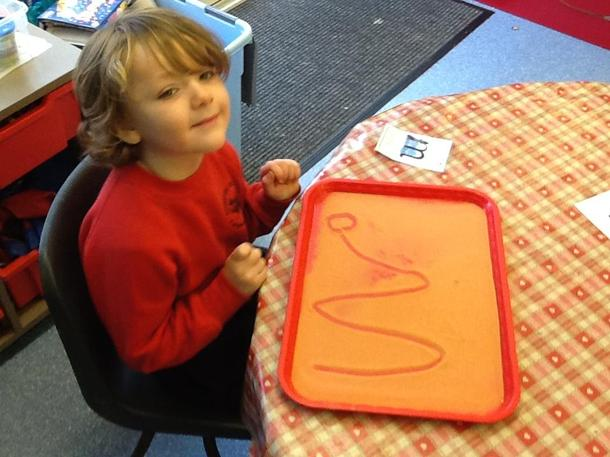 Writing our cursive sounds in sand