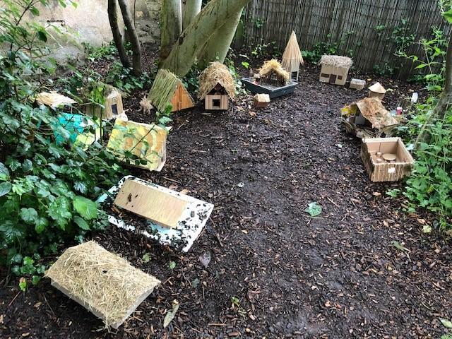 We used the houses we made for our homework to build an Anglo Saxon settlement!