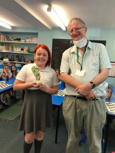 The winner of our Chess Tournament 2021 received her trophy from Paul, our Chess Teacher!