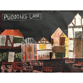 We mixed colours to make our Pudding Lane painting