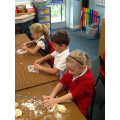 We all kneaded some dough into a roll.