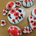 They painted poppies on stones.