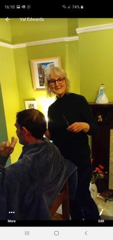 Val cutting her husbands hair well done Val
