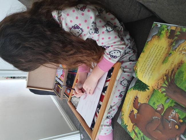 My Halle doing home schooling
