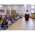 Betsy Harmony teaching Year 3 and 4 a War song