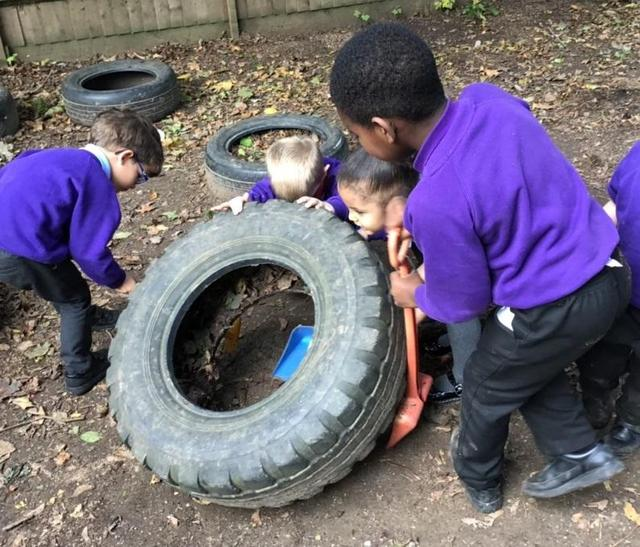Working together to move tyre