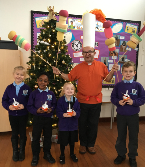 Rev. Lee and children at our Christingle Service