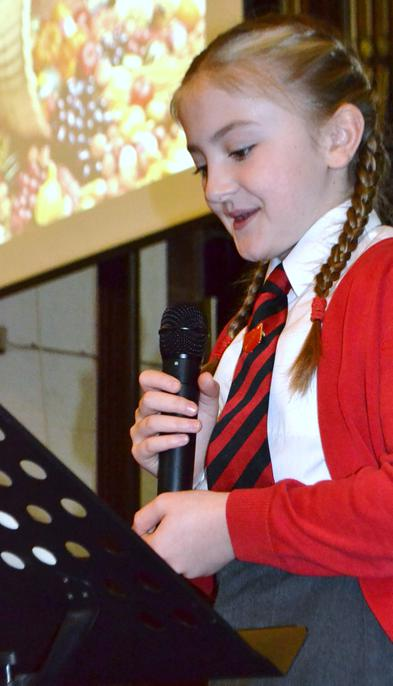 Head girl leading the service