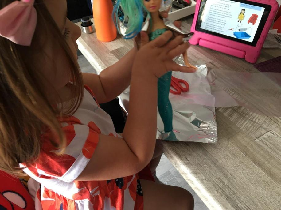 Beth is making a waterproof cape for her doll.