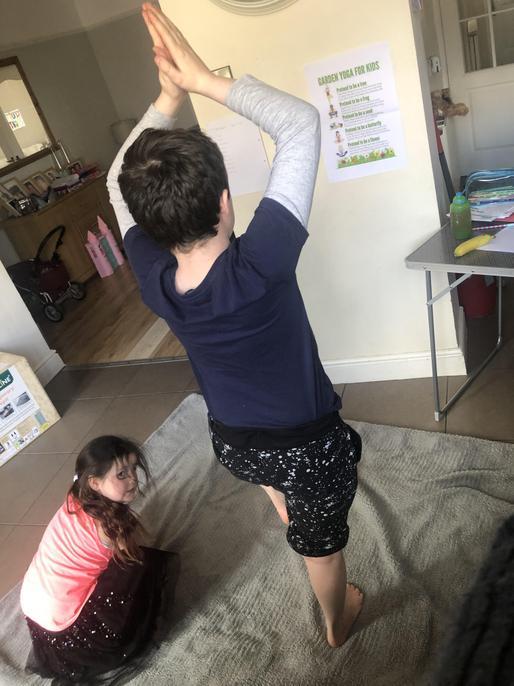Joe and Bella doing yoga.