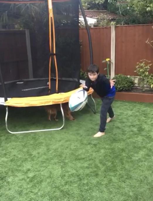 Joe playing rugby.