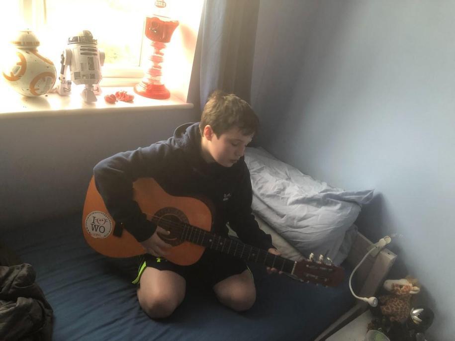 Joe practising his guitar.