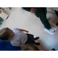 The children measured different staff members feet