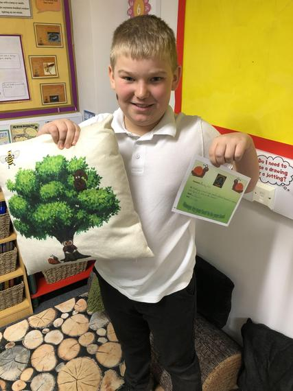 Bailey with his merit award and cushion 🐌