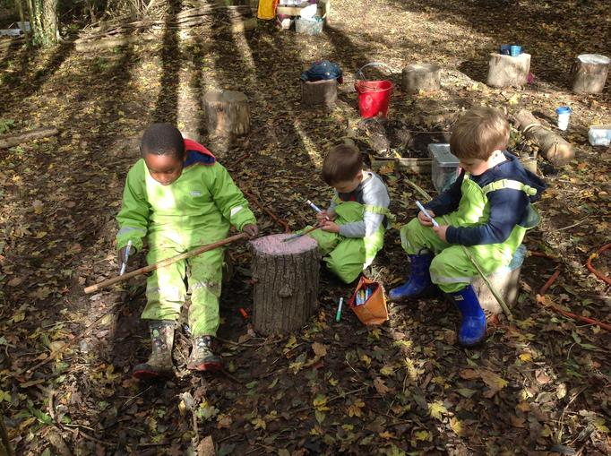 colouring their whittled sticks