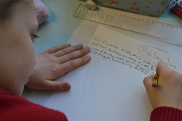 Writing letter from evacuee back home for the film