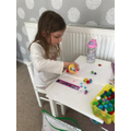 Mrs H's daughter, Phoebe, used pom poms in maths