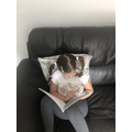 Harriet enjoying reading.