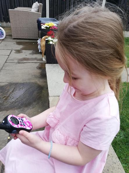 Annie talking to her cousin on the walkie talkie.
