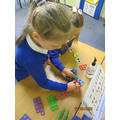 Building up our fine motor skills as well as practising our careful counting.