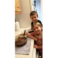 Ellis baking with his sister.