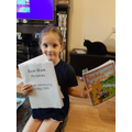 Daisy loves her home learning pack she received.