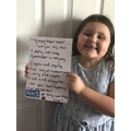 Skyla loves her home learning pack she received.