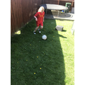 Eva is keeping fit by playing football