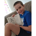Jamie loves his new book from school!