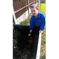 Steven planting in the garden.
