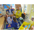 Reading to each other. The 'teacher' reading area.
