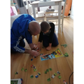 Ellis working with dad on a jigsaw.