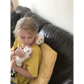 Eva loves her guinea pigs!