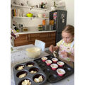 Sophie baking cakes