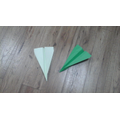 2 green paper planes