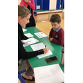 Mrs Hamon checks to see if your name is on the Electoral Register