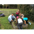 Investec staff help us with the school garden.