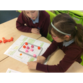 We made our own place value board games.