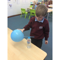 Making a pencil move using a non-contact force - static electricity.