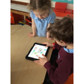 Giving directions using the bee-bot app on the ipads.