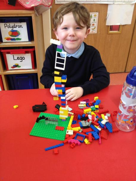 J constructed a Rainbow Flower using Lego
