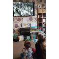 Faye watching VE day on telly!