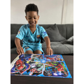 Ziah looks very happy with his Spiderman jigsaw!