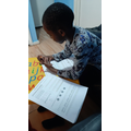 Joshua working hard with his timetables!