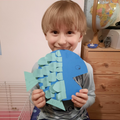 Leon followed the instructions carefully to make his paper fish