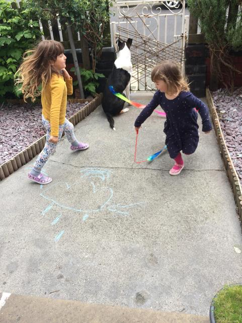 Nina and her sister playing at home